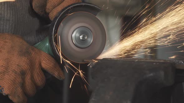 Thumbnail for Close-up Side View of Male Hands Cutting Metal with Grinding Machine. Unrecognizable Man in Working