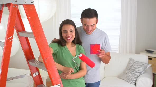Thumbnail for Happy Mexican couple doing home improvements