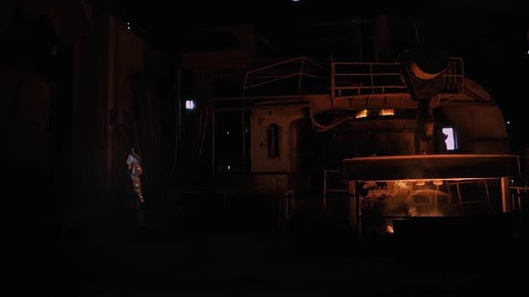 Thumbnail for Foundry Worker wearing a Fire Proximity Suit near Blast Furnace.