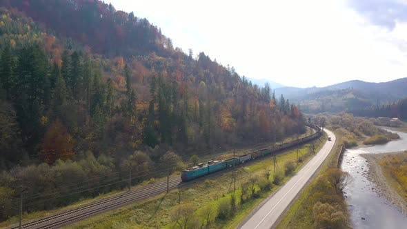 Thumbnail for Autumn in the Mountains: Mountains Covered with Forest, Traffic on the Road and Train Rides on the