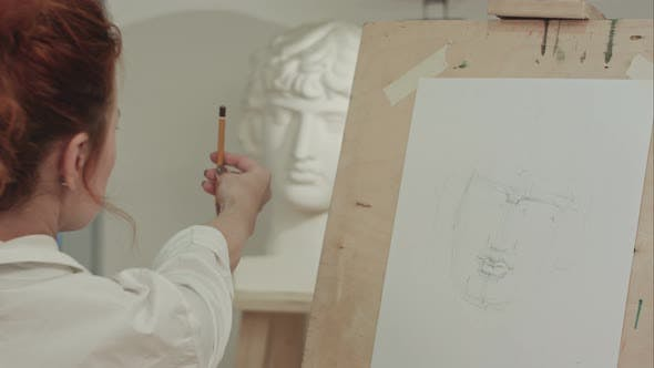 Thumbnail for Concentrated Woman Artist Painting Plaster Bust in Art Studio