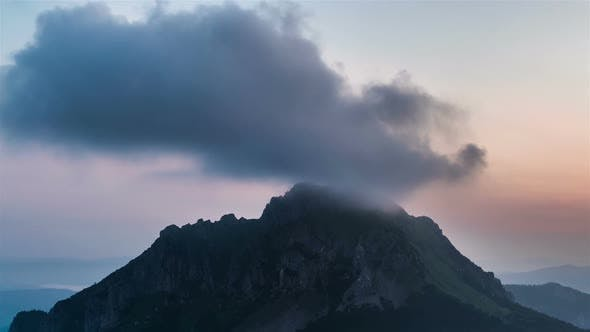 Thumbnail for Clouds in Mountains. Morning Colors before Sunrise