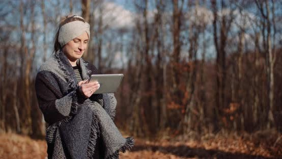 Thumbnail for Woman Using Digital Tablet Outdoors on a Trip
