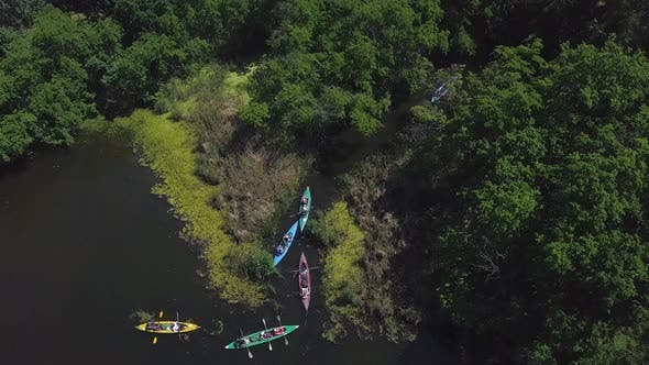 Thumbnail for Kayaks Float on the River