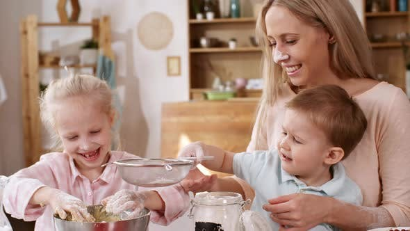 Thumbnail for Smiling Caucasian Mother Making Dough with Kids