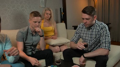Young People Playing Poker in Home