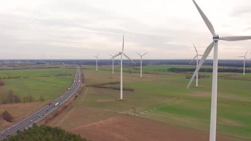 Wind Turbines and Agricultural Fields on a Summer Day - Energy Production with Clean and Renewable