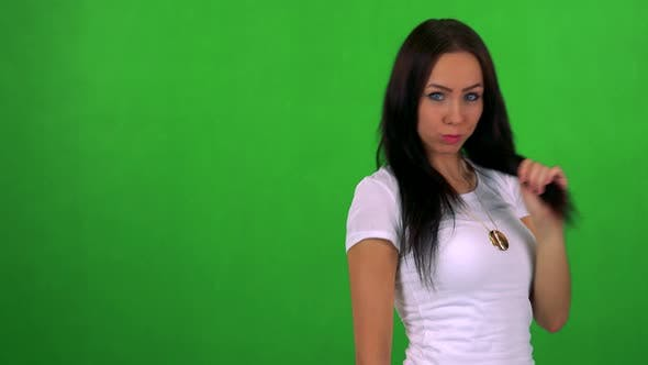 Thumbnail for Young Pretty Woman Does Poses To Camera - Green Screen - Studio