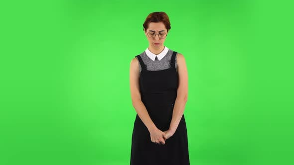 Thumbnail for Funny Girl in Round Glasses Is Very Offended and Looking Away Then Smiling, Green Screen