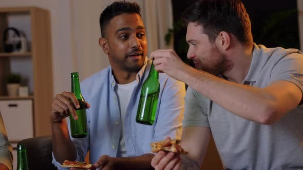 Cover Image for Happy Male Friends with Beer Eating Pizza at Home