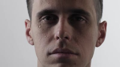 Young Man Crying on White Background