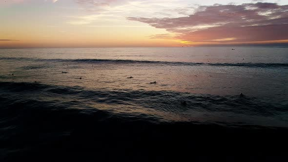 Thumbnail for Aerial View of Surfer Riding Sunset Ocean Wave. Drone Shot Surfing Ocean Lifestyle, Extreme Sports.