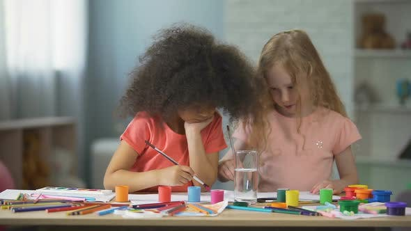 Thumbnail for Carefree Multiracial Female Kids Sitting at The Table and Painting, Art Hobby