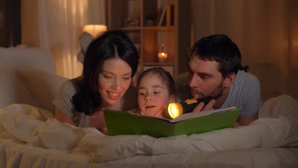Thumbnail for Happy Family Reading Book in Bed at Home 11