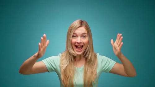 Portrait of Woman Shocked and Surprised with Good News