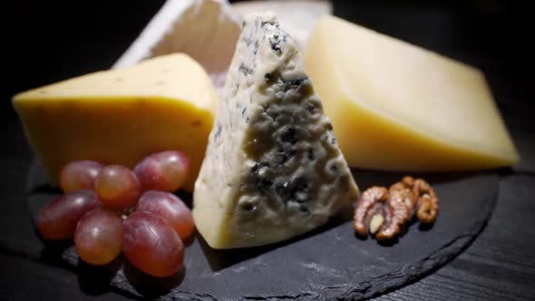 A Variety of Cheeses on a Slate Plate