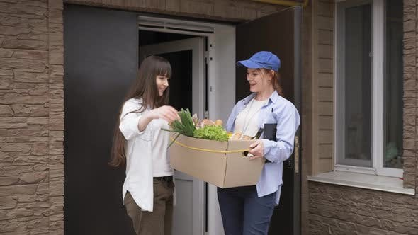 Thumbnail for Online Shop, Young Female Courier Delivering Grocery Cart To Customer Home