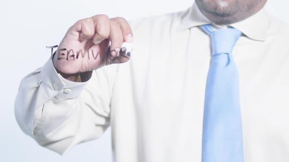 Asian Businessman Writes Teamwork