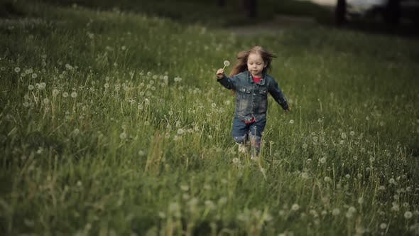 Thumbnail for Happy Little Girl Keeping Dandelion and Running in Park