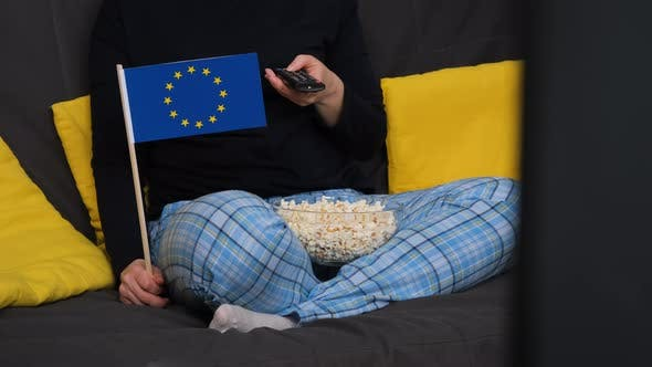 Woman Holding Flag of Europe and Watching Sports