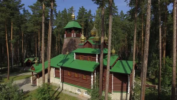 Aerial view of church in Monastery in forest. Sunny summer day