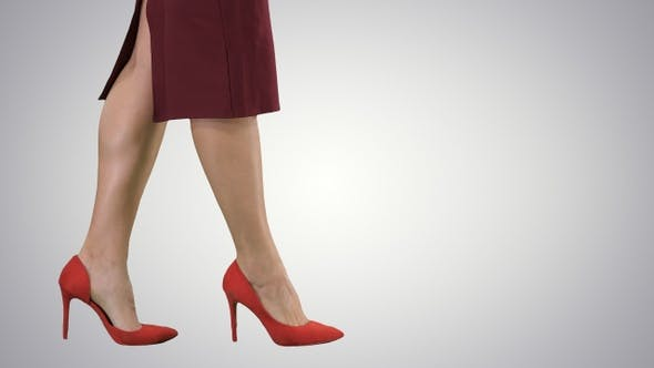Sexy woman legs in red heels walking Business lady, Alpha Channel