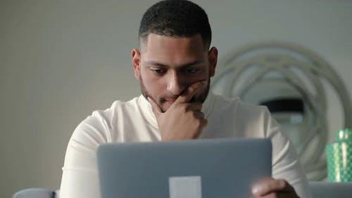 Pensive Entrepreneur Studying Webpage on Tablet Screen