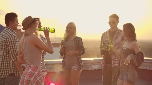 Thumbnail for Six Young People Enjoying a Roof Party