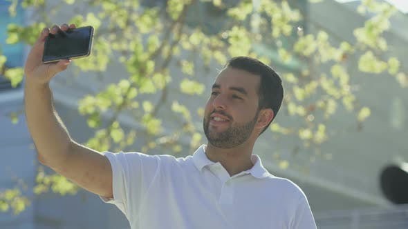 Thumbnail for Smiling Bearded Man Taking Selfie with Smartphone