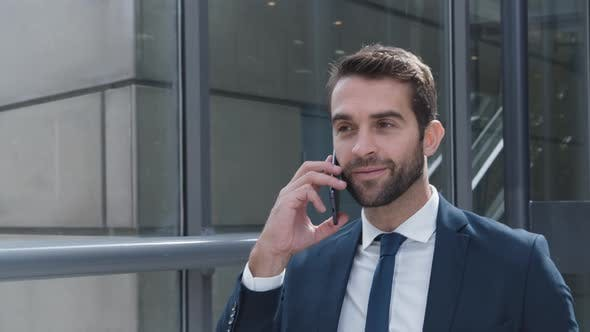 Thumbnail for Businessman Answering Smartphone And Smiling