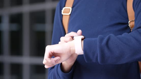 Thumbnail for Woman use of smart watch at outdoor