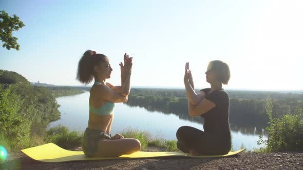 Thumbnail for Two Girls Practice Yoga Outdoors. Slow Motion