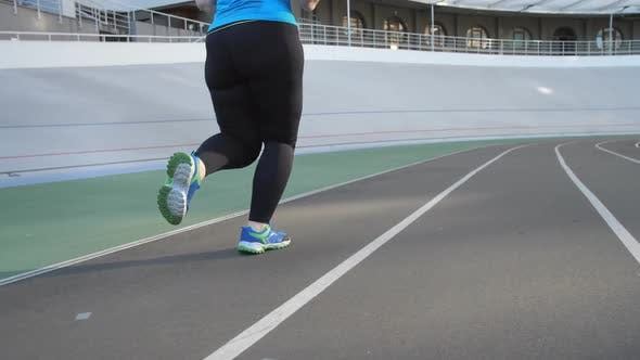 Thumbnail for Legs of Overweight Woman Jogger on Stadium Track