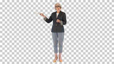 Confident senior lady teacher explaining, Alpha Channel