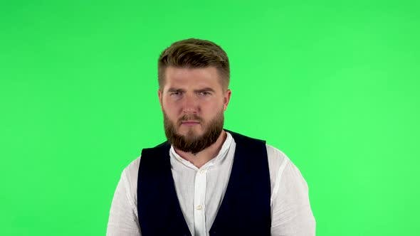 Thumbnail for Man Listens Attentively and Nods His Head Pointing Finger at Viewer Against Green Screen. Green