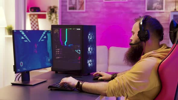 Hipster Man Playing Professional Video Games in His Room