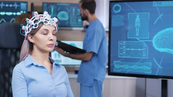 Brain Activity on Tv Screen From Female Patient with Brainwaves Scanning Headest