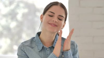 Clapping Young Woman