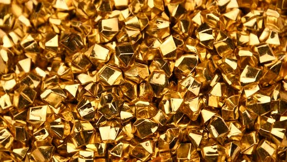 Thumbnail for Abstract background of golden nuggets spinning