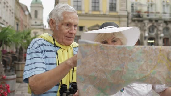 Thumbnail for Senior Two Tourists Having Discussion About Planning Tourist Route in Lviv
