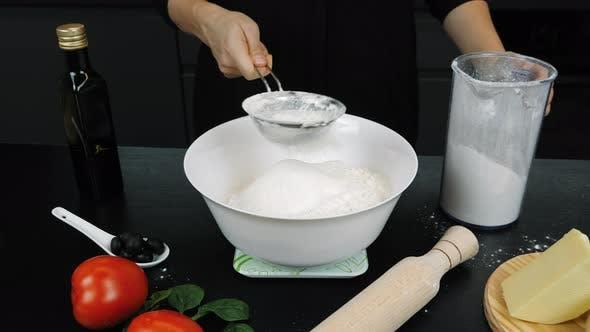 Thumbnail for Flour is sifting through sieve