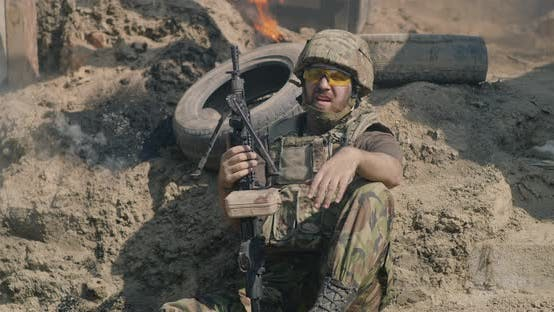 Cover Image for Male Warrior Resting During Battle