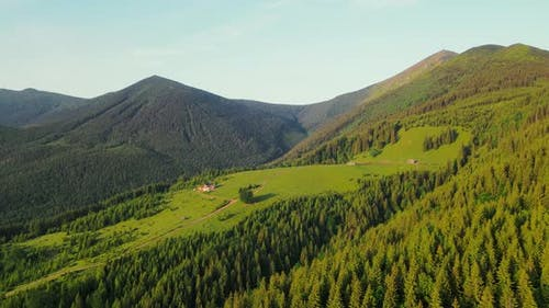 Aerial Flight Over the Fairytale in the Mountains with a Cheese Factory and Old Wooden Houses