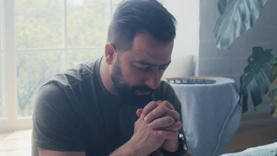 Man Praying and Murmuring