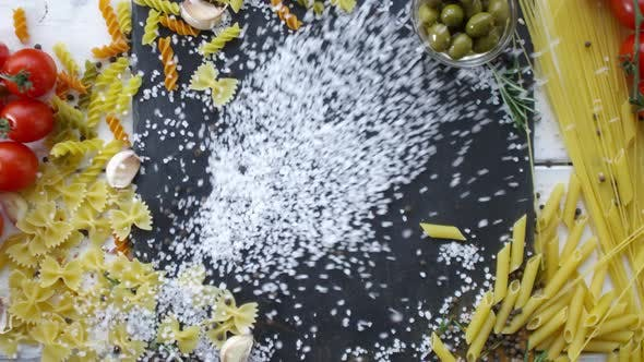 Thumbnail for Heap of Salt Being Thrown on Table with Italian Pasta on It