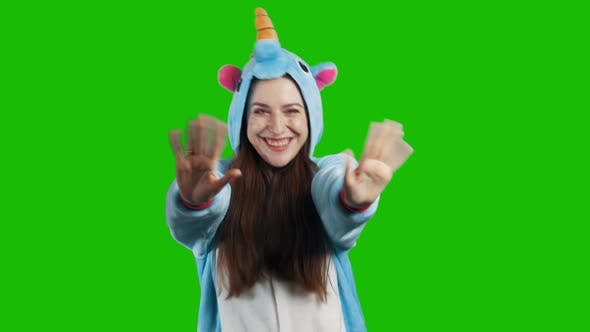 Thumbnail for Portrait of a young brunette girl in unicorn costume