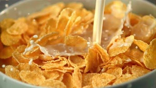 Super Slow Motion Milk Pours Into a Plate of Cornflakes