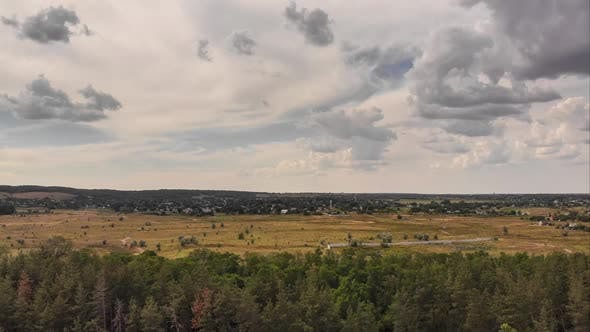 Thumbnail for Hyperlapse Aerial Drone View Over Green Forest with Moving Clouds in Blue Sky