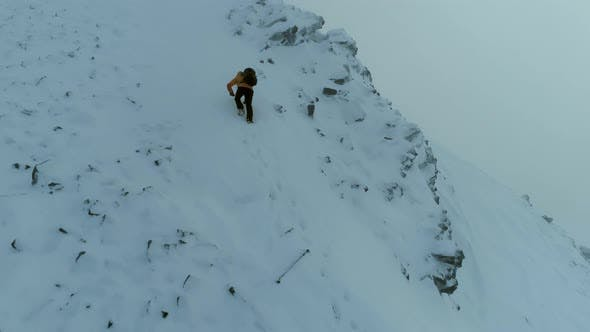 Thumbnail for Mountain Climber on a Challenging Snowy Climb