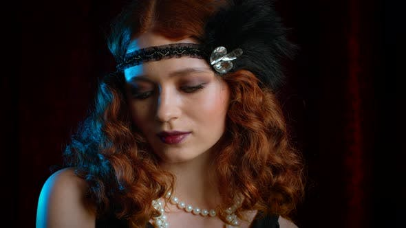 Thumbnail for Portrait of Vintage Woman Dressed in Great Gatsby Posing on Velours Background